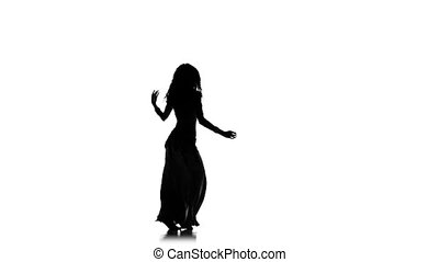 Beautiful exotic belly dancer woman, shaking her hips, on white, slow motion, silhouette