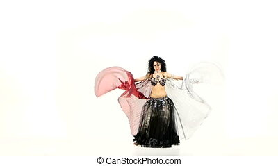 Beautiful exotic belly dancer woman with two wings and shaking her hips, on white, slow motion