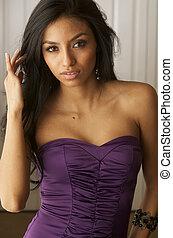 Beautiful exotic woman wearing dress