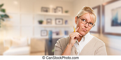 Beautiful Expressive Student or Businesswoman with Pencil in Office.
