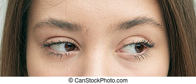 Beautiful eyes, close-up, Caucasian girl, with a sad emotion on her face. Sideways glance