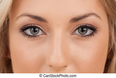 Beautiful eyes. Close-up on woman looking at camera