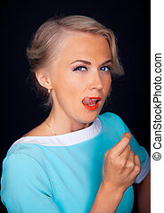 Beautiful face of young adult woman with clean fresh skin - isolated on black