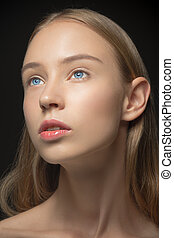 Beautiful face of young woman with clean fresh skin close up