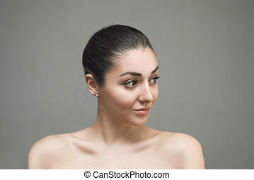 Beautiful Face of Young Woman with Clean Fresh Skin close up isolated on gray. Beauty Portrait. Beautiful Spa Woman Smiling. Perfect Fresh Skin. Pure Beauty Model. Youth and Skin Care Concept