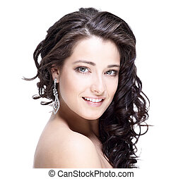 Beautiful face of young woman with