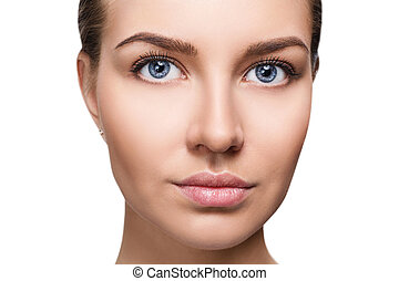 Beautiful face of young woman with perfect skin.