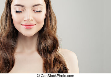 Beautiful face. Pretty woman with clear skin on white background