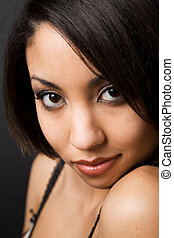 Beautiful face - A face shot of a beautiful black woman in...