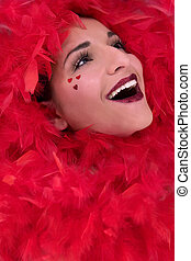 beautiful face with red boa - pretty brunette as a...