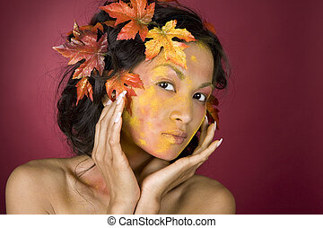 beautiful fall face - pretty brunette woman wearing leaves...