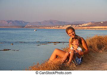 Beautiful family enjoying the evening on a beach
