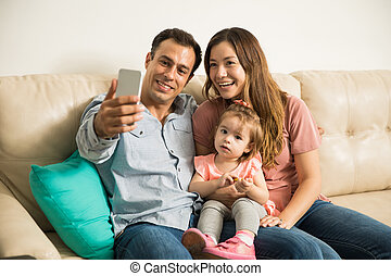 Beautiful family of three taking a selfie