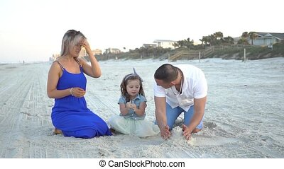 beautiful family on the beach