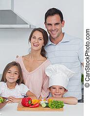 Beautiful family standing in the ki