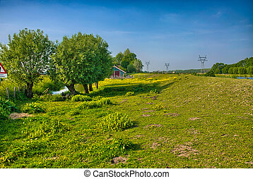 Beautiful farm landscape with trees and grass fields,...