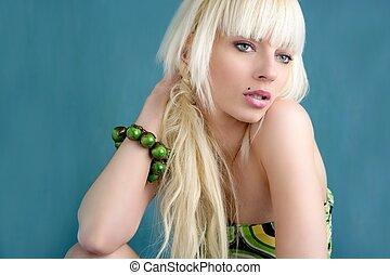 beautiful fashion blonde girl portrait green background
