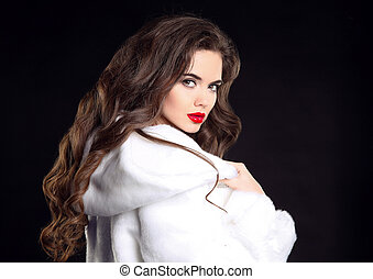 Beautiful fashion brunette woman portrait in white fur coat