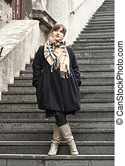 Beautiful fashion girl on stairs posing