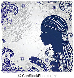 Beautiful fashion girl on the ornamental background