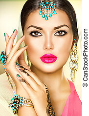 Beautiful fashion Indian woman portrait with oriental jewels