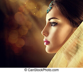 Beautiful fashion Indian woman profile portrait with oriental accessories