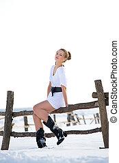Picture of beautiful fashion model in winter farm