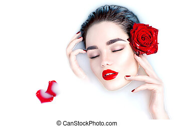 Beautiful fashion model girl taking milk bath, spa and skin care concept