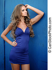 beautiful fashion model in a blue dress