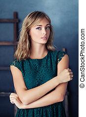 Beautiful fashion model in green dress, portrait