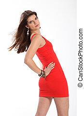 Beautiful fashion model posing in short red dress