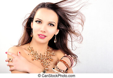 Beautiful fashion woman with jewelry accessories