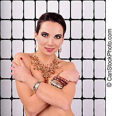 Beautiful fashion young woman with jewelry accessories on the abstract background