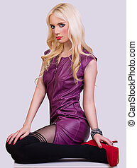 Beautiful fashionable blonde girl in violet dress