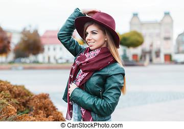 Beautiful fashionable girl posing in the city