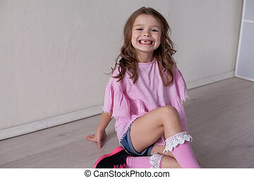 beautiful fashionable little girl portrait on a white background