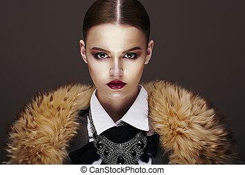 Beautiful Fashionable Strict Fashion Model in Fur Coat....