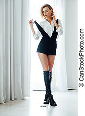 Beautiful fashionable woman blonde clothes white shirt black portrait shorts
