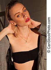 beautiful fashionable woman blonde portrait on a white background