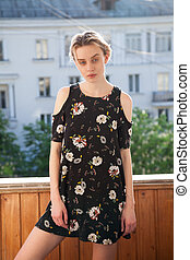 beautiful fashionable woman in a dress with flowers style blonde