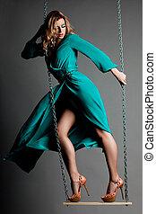 beautiful fashionable woman in blue dress