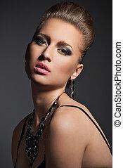Beautiful fashionable woman with beautiful makeup
