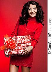 beautiful fashionable woman with gift box