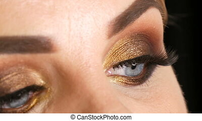 Beautiful fat woman model with gold makeup, smoky eyes dark...