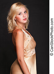 Beautiful female blonde fashion model in yellow dress