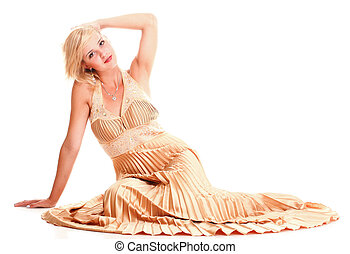 Beautiful female blonde fashion model in yellow dress isolated