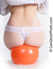 beautiful female buttocks on a rubber ball
