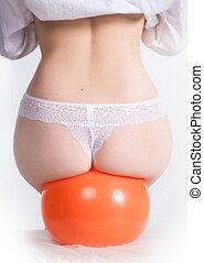 beautiful female buttocks on a rubber ball