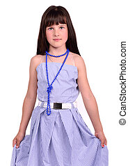 Beautiful female child wearing her mother's evening dress which is too big for her