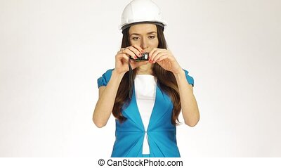 Beautiful female construction engineer or architect in hard...